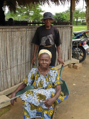 Papa Jerome used to use the wheelbarrow to take Mama Hélène everywhere.  This is them arriving at our eye centre