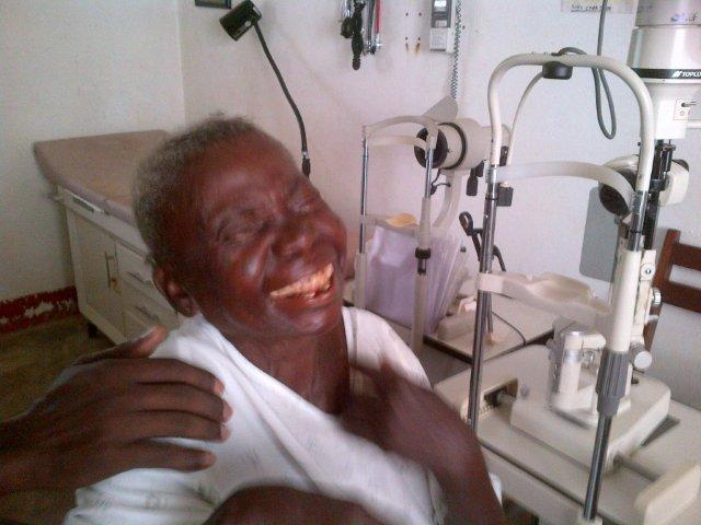 A laughing Mama Hélène as she received the Priceless Gift of Sight 3