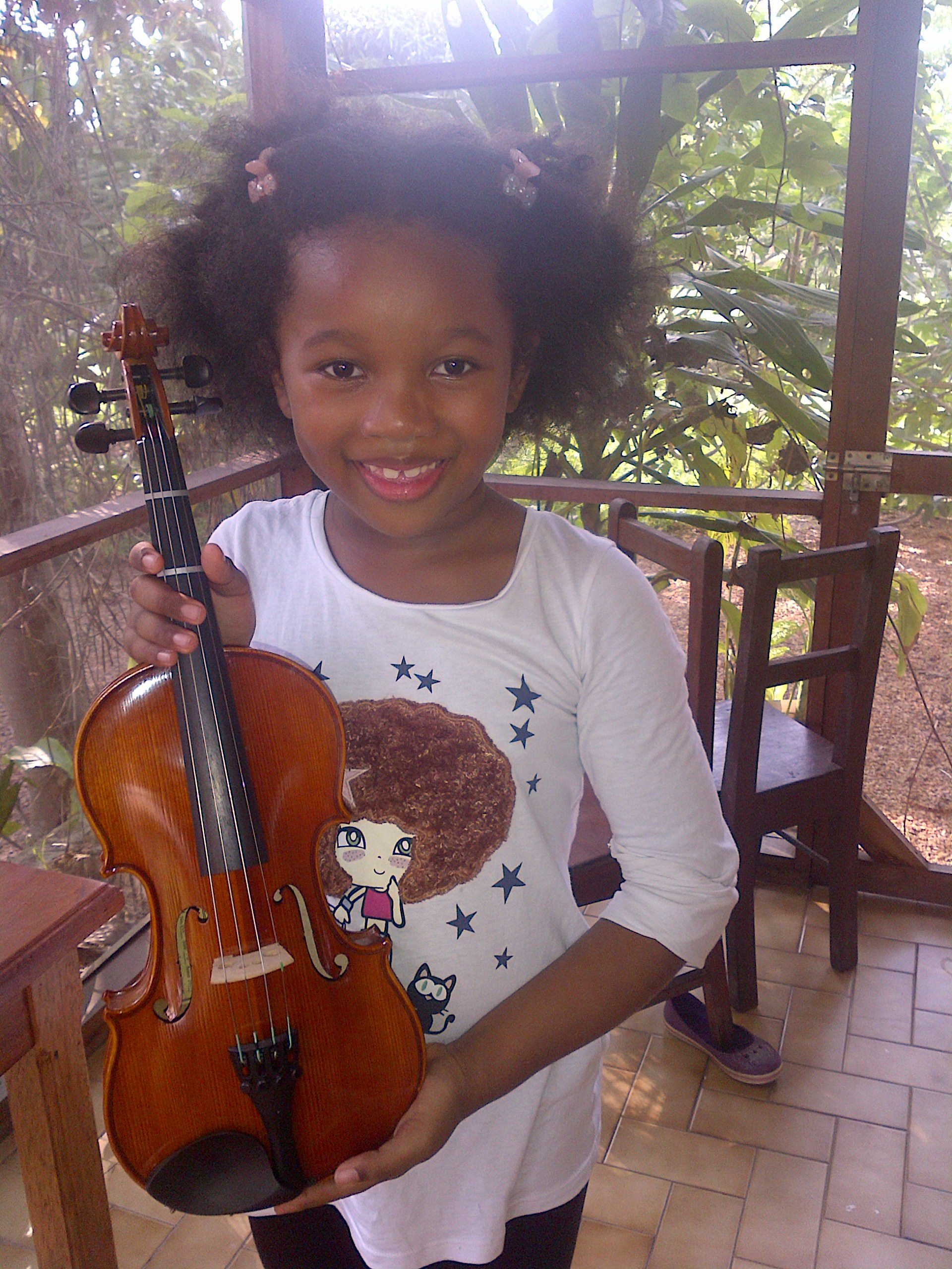 The day Cherissa received her violin and found out that Kate would teach her